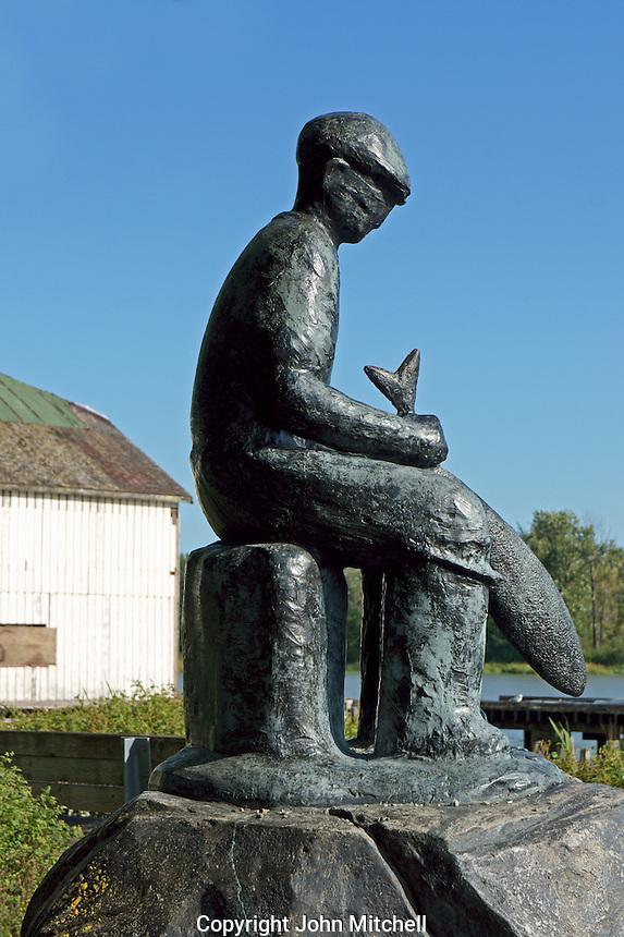 Black bronze Japanese Fishermen's Memorial statue in the Britannia Heritage Shipyard, Steveston, British Columbia, Canada