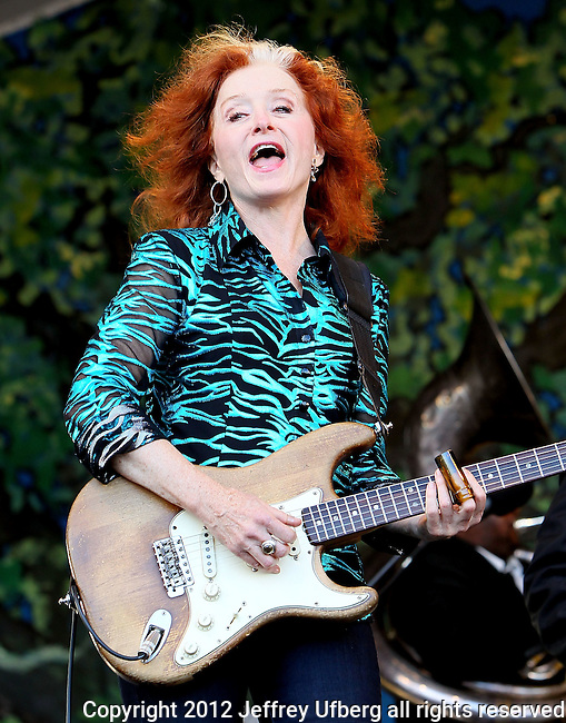 NEW ORLEANS, LA - MAY 06: Singer/musician Bonnie Raitt performs with the Preservation Hall Jazz Band during the 2012 New Orleans Jazz & Heritage Festival at the Fair Grounds Race Course on May 6, 2012 in New Orleans, Louisiana