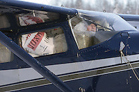 February 16, 2013  Volunteer Iditarod Air Force pilot Bill Mayer taxis with a load bound for Rainy Pass at the Willow airport as musher food, straw, HEET and people food is flown to the 4 checkpoints on the east side the Alaska Range. ..Iditarod 2013 Photo Copyright Jeff Schultz  -- Do not reproduce without written permission