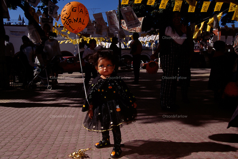 Children dress in costumes for a parade in Atlixco during the week of Day of the Dead celebration. Dia de los Muertos is Mexico's most characteristic fiesta. The souls of the dead return to the earth this day.