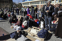 Pictured: Migrants are resting on the ground Thursday 03 March 2016<br />