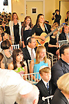 A Hebrew Wizards Bat Mitzvah service beginning with a musical procession led by the cantor.  Rabbi Deborah Solomon follows the Bat Mitzvah girl.