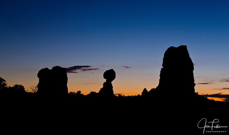 Sunset silhouette of Balanced Rock in Arches National Park near Moab, Utah, USA.