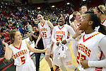 Divine Savior Holy Angels teammates Grace Thomas, left, Margaret Riley, Arike Ogunbowale and Shanice Cole celebrate their victory over D.C. Everest during the WIAA Div. 1 Girls Basketball State Championship at the Resch Center in Green Bay, Wis., on March 14, 2015. Photo by Corey Wilson
