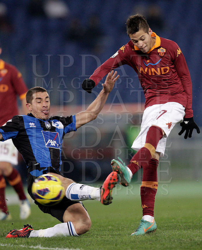 Calcio, ottavi di finale di Coppa Italia: Roma vs Atalanta. Roma, stadio Olimpico, 11 dicembre 2012..AS Roma forward Nico Lopez, of Uruguay, kikcs the ball as Atalanta midfielder Carlos Carmona, of Chile, left, challenges him during their Italy Cup last-16 tie football match between AS Roma and Atalanta at Rome's Olympic stadium, 11 december 2012. .UPDATE IMAGES PRESS/Riccardo De Luca