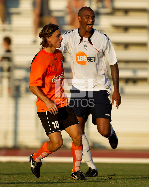 Jorge Herrera of the Charlotte Eagles and Zat Knight of the Bolton Wanderers watch the play during a a friendly in Charlotte.  The Charlotte Eagles currently in 3rd place in the USL second division played a friendly against the Bolton Wanderers from the English Premier League on 7/14/10 losing 3-0.