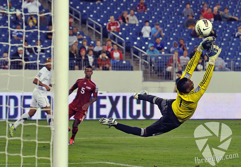 NASHVILLE, TN - MARCH 22: Goalkeeper Disnel Cooper #1 of Cuba dives to make a save in the Men's Olympic Qualifying match against the USA at LP Field on March 22, 2012 in Nashville, Tennessee.  (Photo by Frederick Breedon/Getty Images) *** Local Caption *** Disnel Cooper