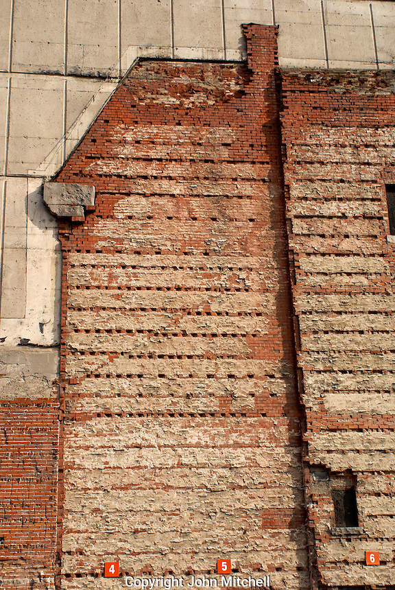 Imprint of a demolished old brick house on the side of a new concrete building in Montreal, Quebec, Canada
