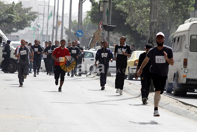 "Palestinian youth take part in the symbolic marathon of Jerusalem titled ""Freedom for Prisoners"" in Gaza City on March 14, 2013 in response to the Jerusalem Marathon which was attended by 20000 racers from 52 countries in the Jerusalem and The Palestine Liberation Organisation called to boycott it saying involvement implies acceptance of Israel's illegal annexation of the city's eastern sector. Photo by Naaman Omar"