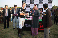 Her Highness Rajmata Padmini Devi of the Jaipur Royal family (right) presents a trophy to a polo player from the Western Australia Polo Team after a close match for the Argyle Pink Diamond Cup, organised as part of the 2013 Oz Fest in the Rajasthan Polo Club grounds in Jaipur, Rajasthan, India on 10th January 2013. Photo by Suzanne Lee