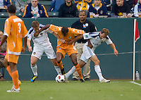 Puerto Rico Islanders Christopher Nurse (8) tries to escape from LA Galaxy midfielder Chris Birchall (11) and Eddie Lewis (6). The Puerto Rico Islanders defeated the LA Galaxy 4-1 during CONCACAF Champions League group play at Home Depot Center stadium in Carson, California on Tuesday July 27, 2010.Puerto Islanders Alexis Rivera (5)