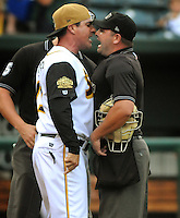 Kelly.Jordan@jacksonville.com--071213--Suns manager Andy Barkett, left, gets in the face of home plate umpire Jeremy Riggs just after he ejected Barkett following a dispute over a call at homeplate as the Jacksonville Suns take on the Mobile BayBears on Bragan Field at the Baseball Grounds of Jacksonville in Jacksonville, Florida Friday night, July 12, 2013.(The Florida Times-Union,Kelly Jordan)