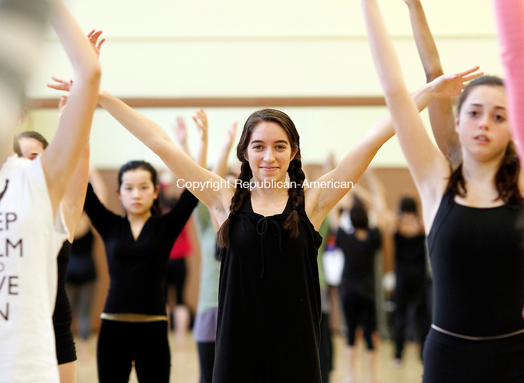 Middlebury, CT-15 February 2012-021512CM04- Stephanie Sorosiak, 16, and a captain with the Westover Dance ensembles follows along with Lorelei Chang, the Artistic Director of dancEnlight as she teaches a masters dance class to students from Westover, Taft and Miss Porter's School at the Westover School Wednesday afternoon in Middlebury.  Westover held it's second annual Dance Slam Competition following the one hour masters dance class.  The adjudicated dance competition consisted of pieces choreographed by students and dance faculty.   Christopher Massa Republican-American