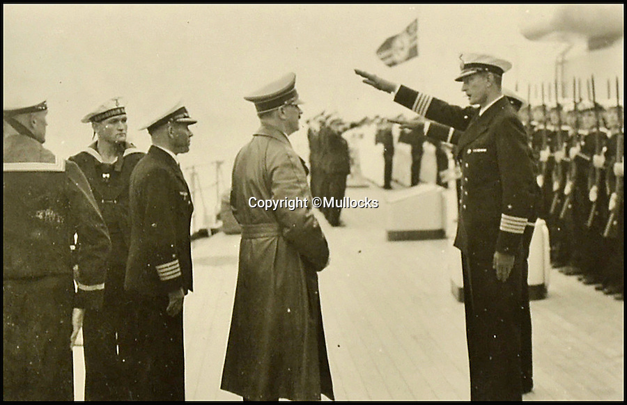 BNPS.co.uk (01202 558833)<br /> Pic: Mullocks/BNPS<br /> <br /> Adolf Hitler gets a tour of the boat.<br /> <br /> A German sailor's personal photo album capturing Hitler's visit to his doomed ship on which almost 2,000 men later perished has emerged for the first time. <br /> <br /> Showing the Fuhrer inspecting the ill-fated crew and greeting senior personnel, the 81 images were taken on board the infamous Nazi battleship Scharnhorst between 1939 and 1940. <br /> <br /> The 771ft vessel was sunk during the Battle of the North Cape in 1943 by HMS Duke of York with only 36 of a crew of 1,968 surviving. <br /> <br /> And this album, compiled by an unidentified German sailor, shows what life was like on Scharnhorst before that day. It will be sold by Mullocks Auctions in Shropshire on October 18 with a £650 estimate.