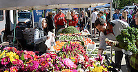 People enjoy the Dane County Farmer's Market on Saturday, September 12, 2015, in Madison, Wisconsin