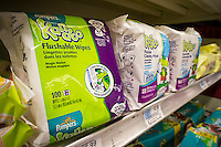 """Packages of Pampers Kandoo brand wipes are seen on a supermarket shelf in New York on Thursday, February 12, 2015. The wipes including other brands, which are advertised as """"flushable"""", clog up the sewer systems as they do not break down like toilet paper and should not be disposed of in the toilet. Municipalities are spending millions unclogging sewers and the New York City Council is proposing a ban that would prevent the products from being advertised as """"flushable"""". (© Richard B. Levine)"""
