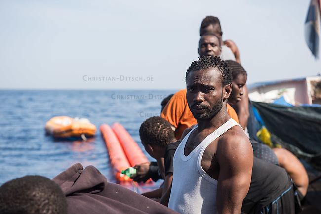 Sea Watch-2.<br /> Die Sea Watch-2 bei ihrer 13. SAR-Mission vor der libyschen Kueste.<br /> Im Bild: Gefluechtete an Bord der Sea Watch-2. Sie haben in der Nacht Freunde verloren. Sie sind ertrunken bervor die Sea Watch-Crew sie erreichen konnte.<br /> 21.10.2016, Mediterranean Sea<br /> Copyright: Christian-Ditsch.de<br /> [Inhaltsveraendernde Manipulation des Fotos nur nach ausdruecklicher Genehmigung des Fotografen. Vereinbarungen ueber Abtretung von Persoenlichkeitsrechten/Model Release der abgebildeten Person/Personen liegen nicht vor. NO MODEL RELEASE! Nur fuer Redaktionelle Zwecke. Don't publish without copyright Christian-Ditsch.de, Veroeffentlichung nur mit Fotografennennung, sowie gegen Honorar, MwSt. und Beleg. Konto: I N G - D i B a, IBAN DE58500105175400192269, BIC INGDDEFFXXX, Kontakt: post@christian-ditsch.de<br /> Bei der Bearbeitung der Dateiinformationen darf die Urheberkennzeichnung in den EXIF- und  IPTC-Daten nicht entfernt werden, diese sind in digitalen Medien nach &sect;95c UrhG rechtlich geschuetzt. Der Urhebervermerk wird gemaess &sect;13 UrhG verlangt.]