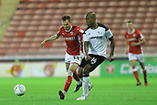 12th September 2017, Oakwell, Barnsley, England; Carabao Cup, second round, Barnsley versus Derby County; Andre Wisdom of Derby County passes the ball as Ryan Hedges of Barnsley FC misses the tackle