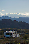RV camping in the desert with scenic background