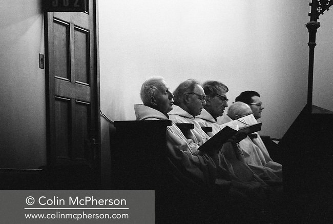 Monks at dawn prayers in the chapel at Sancta Maria Abbey at Nunraw, East Lothian, home since 1946 to the Order of Cistercians of the Strict Observance. Around 15 monks were resident at Nunraw in 1996, undertaking a mixture of daily tasks and strict religious observance. The present purpose-built building dates from 1969 when the monks moved from the nearby Nunraw house.