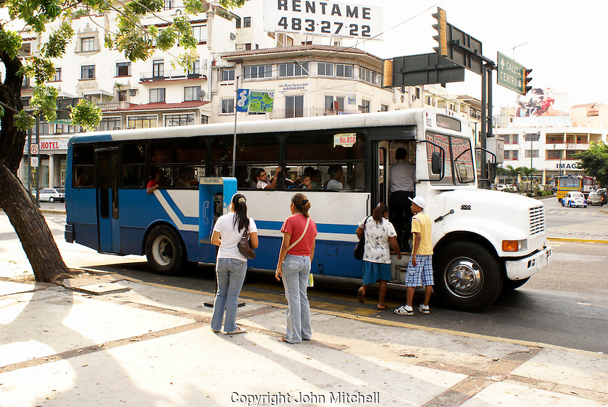 People boarding a public bus in Acapulco, Guerrero,  Mexico