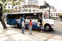 People boarding a public bus in Acapulco, Guerrero,  Mexico