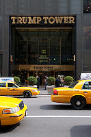 The doors and facade of the Trump Tower on 5th Ave on Manhattan. Yellow taxis near the Trump Tower.