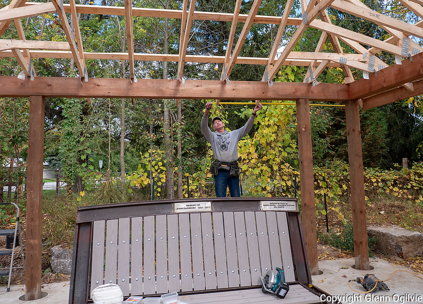 Harold Peters a carpenter and lead hand for Southwest Fence and Deck is seen installing a gazebo roof on the Howard Watson Trail.