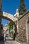 The Ecce Homo Arch, with the windows in it, is over the Via Dolorosa and was originally part of Hadrian's Arch.  The Basilica of Ecce Homo in the Muslim Quarter was built over part of this structure.  The Old City of Jerusalem and its Walls is a UNESCO World Heritage Site.  The Church of the Condemnation is at right.