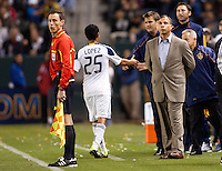 LA Galaxy forward Miguel Lopez (25) exsits the field as head coach Bruce Arena looks on. The LA Galaxy defeated the Philadelphia Union 1-0 at Home Depot Center stadium in Carson, California on  April  2, 2011....