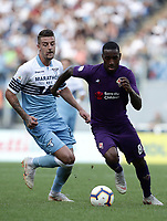 Football, Serie A: S.S. Lazio - Fiorentina, Olympic stadium, Rome, 7 ottobre 2018. <br /> Fiorentina's Santos Da Silva Gerson (r) in action with Lazio's Sergej Milinkovic (l) during the Italian Serie A football match between S.S. Lazio and Fiorentina at Rome's Olympic stadium, Rome on October 7, 2018.<br /> UPDATE IMAGES PRESS/Isabella Bonotto