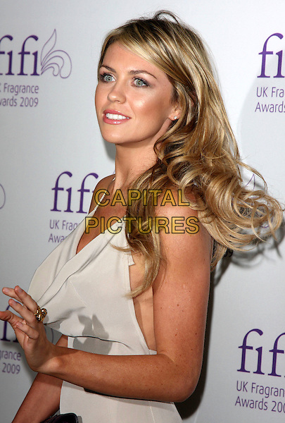 ABIGAIL CLANCY.Fifi UK Fragrance Awards 2009, The Dorchester hotel, London, England..April 22nd 2009.half length beige grey gray dress hand gold ring abi abby abbey clancey.CAP/ROS.©Steve Ross/Capital Pictures.