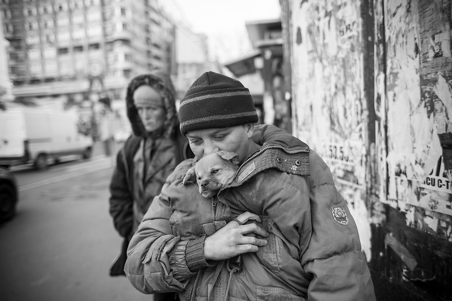 Maddalena Ilie, 22, with her dog and her mother, 38 year-old Flori Ilie. Both are addicted to huffing paint and homeless in Bucharest.