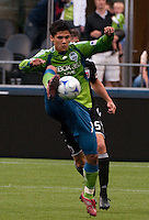 Fredy Montero (l) of the Seattle Sounders shows some fancy footwork against  Santino Quaranta (r) of DC United in the match played on June 17, 2009 at Quest Field in Seattle, WA. The Sounders and United played to a 3-3 draw.