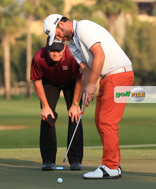 Jamie Gough helps Andy Sullivan (ENG) out with the line of putt during the Pro-Am at the 2016 Omega Dubai Desert Classic, played on the Emirates Golf Club, Dubai, United Arab Emirates.  03/02/2016. Picture: Golffile | David Lloyd<br /> <br /> All photos usage must carry mandatory copyright credit (&copy; Golffile | David Lloyd)