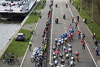 Peloton besides the canal on the local laps in Schoten<br /> <br /> 105th Scheldeprijs 2017 (1.HC)<br /> 1day race: Mol &gt; Schoten 200km