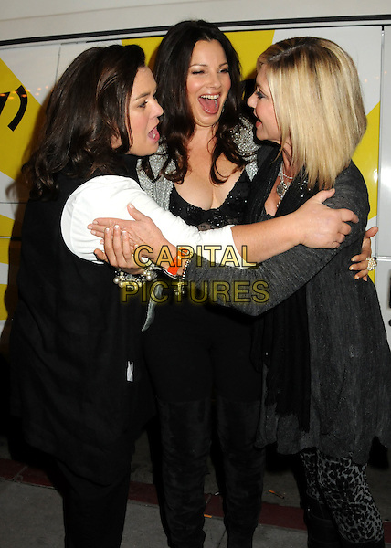 "ROSIE O'DONNELL, FRAN DRESCHER & OLIVIA NEWTON-JOHN.""The Million Dollar Revival"" Benefit for Fran Drescher's Cancer Schmancer Charity Movement held at the Million Dollar Theatre, Los Angeles, California, USA..December 13th, 2009.half length black white grey gray jacket top hug embrace mouth open smiling profile .CAP/ADM/BP.©Byron Purvis/AdMedia/Capital Pictures."