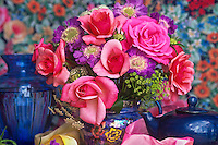 Rose bouquet with pink rose 'First Prize' with floral wallpaper background