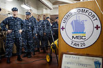 Navy medical personnel stand ready to load relief supplies on board the USNS Comfort, a naval hospital ship,  before its mission to help survivors of the earthquake in Haiti on Friday, January 15, 2010 in Baltimore, MD.