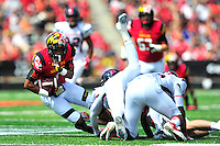 Terrapins D.J. Moore is tackled after catching the ball. Maryland defeated Richmond 50-21 during home season opener at the Byrd Stadium in College Park, MD on Saturday, September 5, 2015.  Alan P. Santos/DC Sports Box