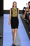 Alla walks runway in a carbon black crepe dress with lace blocked front, by Monique Lhuillier, from the Monique Lhuillier Spring 2012 collection fashion show, during Mercedes-Benz Fashion Week Spring 2012.