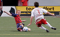Kenny Cutler (15) slides for the ball against Danny O'Rourke (3) as Eddie Pope (23) looks on in the New York Red Bulls vs. Real Salt Lake 1-1 tie at Rice Eccles Stadium in Salt Lake City, Utah April 15, 2006