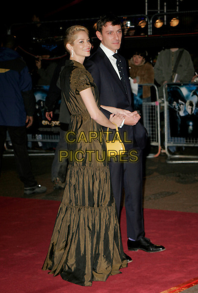 """SIENNA GUILLORY & ENZO CILENTI.Arrivals - """"Eragon"""" World Premiere, .Odeon Leicester Square, London, .England, December 11th 2006..full length green brown dress long yellow bag.CAP/AH.©Adam Houghton/Capital Pictures"""