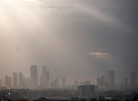Rain and sun-rays over Manila, Philippines