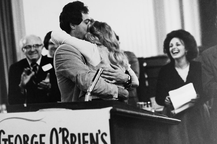 Rep. Marty Russo, D-Ill., kisses Jons Gardna - aid to Rep. George M. O'Brien, R-Ill., on Jan. 20, 1979. (Photo by CQ Roll Call)