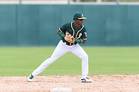 Oakland Athletics second baseman Marcos Brito (5) prepares to make a throw to first base during an exhibition game against Team Italy at Lew Wolff Training Complex on October 3, 2018 in Mesa, Arizona. (Zachary Lucy/Four Seam Images)