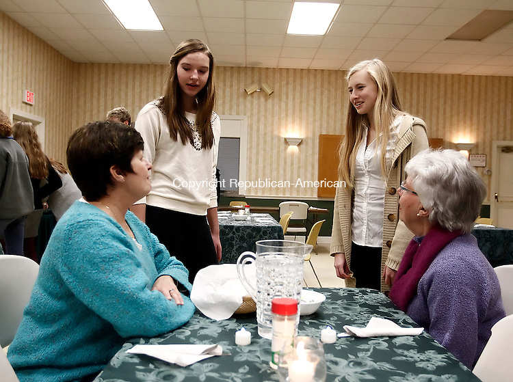 Southbury, CT- 26 January 2014-012614CM11- Lindsay Scott, 15, left, and Meryl Bucciarelli, 15, of Southbury wait on Linda Langley, left, and her mom Pat Erhard, both of Southbury, during a pasta dinner fundraiser to benefit the Senior Pilgrim Fellowship Youth Group at the United Methodist Church of Christ in Southbury on Sunday.  The event is one of the fundraisers put on by the group, which funds missions trips and the supplies needed for the rebuilding the communities.  The group plans on going to Wisconsin in the summer to help out communities, said Elena Hamm, a parent leader. Christopher Massa Republican-American