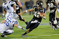 11 October 2008:  FIU quarterback Paul McCall (12) scrambles while being pursued by Middle Tennessee State defensive lineman Wes Hofacker (56) and defensive lineman Jonathan Presley (95) in the FIU 31-21 victory over Middle Tennessee at FIU Stadium in Miami, Florida.
