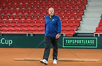 The Hague, The Netherlands, September 11, 2017,  Sportcampus , Davis Cup Netherlands - Chech Republic, training,  coach Raymond Knaap (NED) sweeping the clay<br /> Photo: Tennisimages/Henk Koster