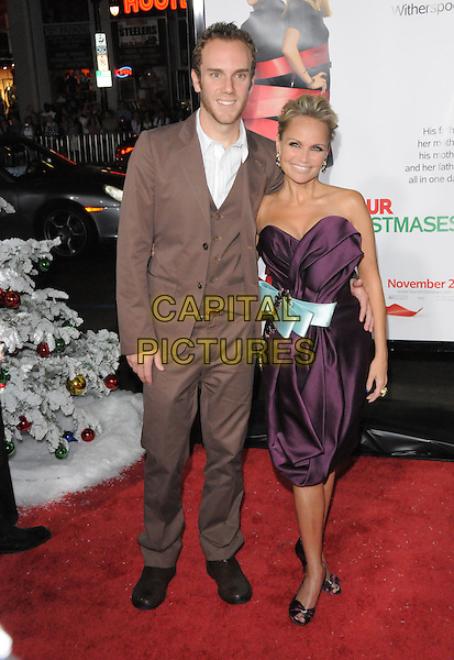 """CHARLIE & KRISTIN CHENOWETH.World Premiere of """"Four Christmases"""" held at The Kodak Theatre in Hollywood, California, USA..November 20th, 2008                                                                     .4 full length strapless dress purple aubergine blue bow sash ribbon brown suit couple waistcoat.CAP/DVS.©Debbie VanStory/Capital Pictures."""